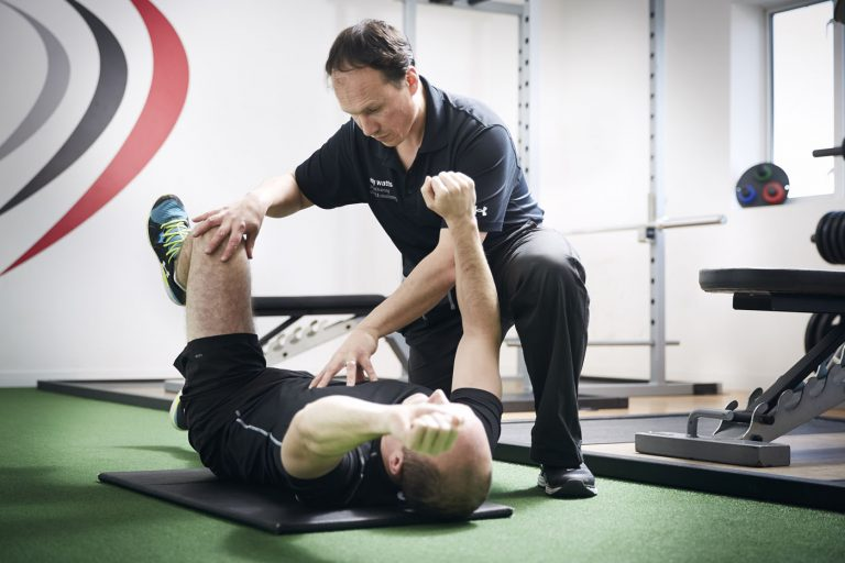 Personal trainer showing a core strength exercise