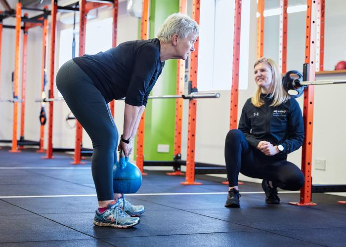 Female training with a female trainer