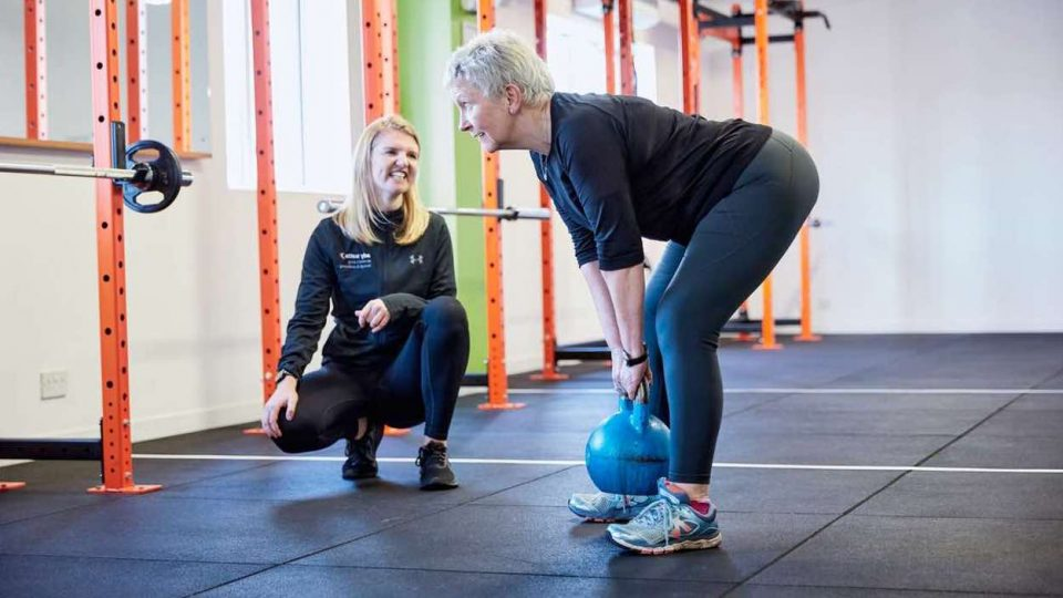 Lady Training with female personal trainer