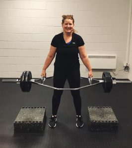 Strength small group training trap bar deadlift