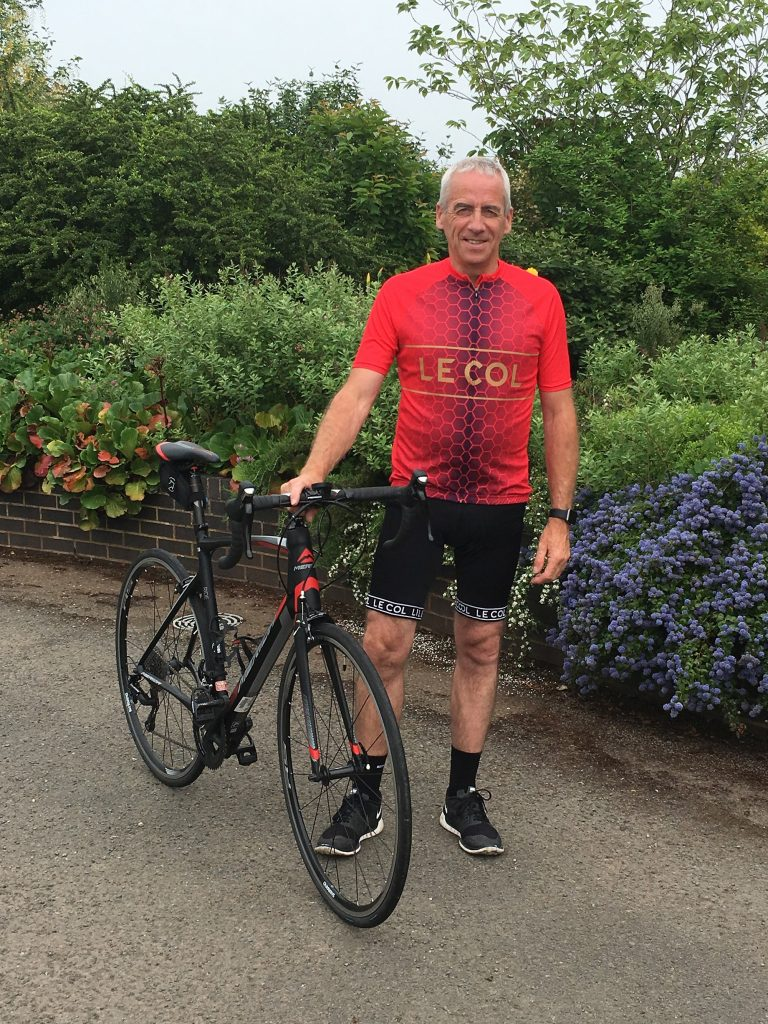 A man stood by his bike