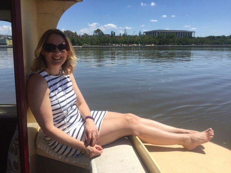 A female sat on a boat