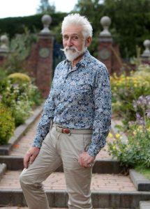 A man stood in a lavish garden